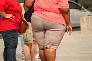A fat woman standing