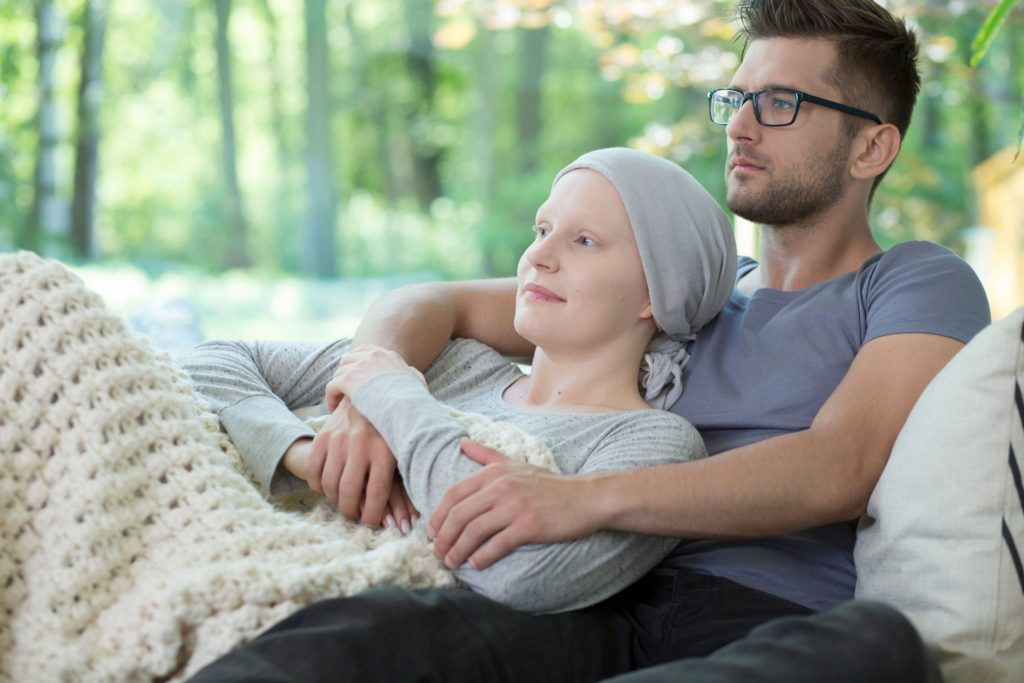 boyfriend with their cancer stricken girlfriend at home